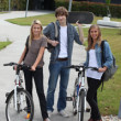 students riding bikes to college