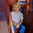 boy sitting on drawer steps of maxtrix bunk bed