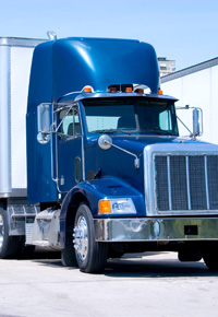 blue tractor trailor truck front