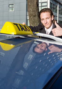 male in suit taxi driver thumbs up
