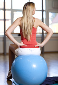 sitting on exercise ball