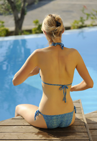 back of woman by pool