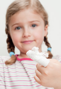 little girl with hurt finger