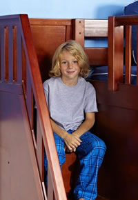 boy sitting on drawer steps of maxtrix bunk bed