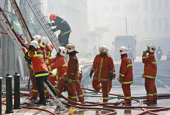 fireman climbing ladder to apartment