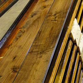 Pioneer Collection Walnut flooring with smoke accents being finished with Waterlox Tung oil