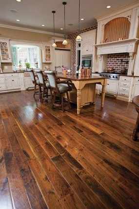 Walnut flooring with hand distressed surface, soft edges, flush pegs, smoke accent & Tung oil finish