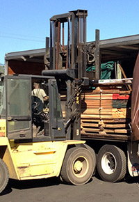 Loading wood with forklift at J Gibson McIlvain