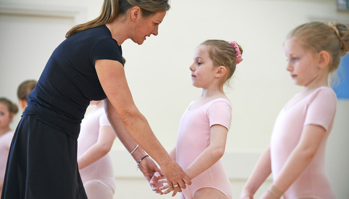 dance instructor with young girls