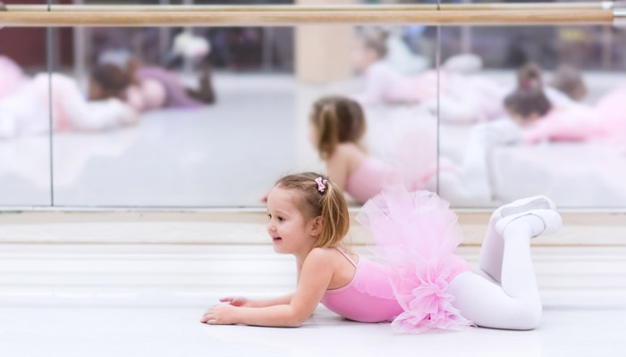 young ballerina in group class