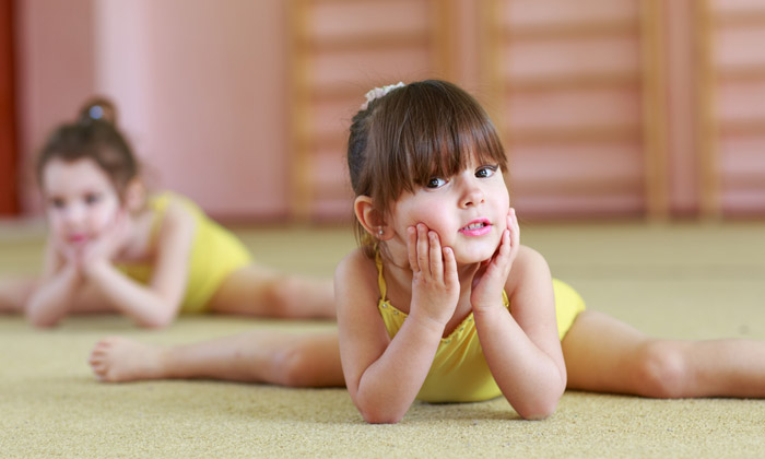 preschool girls in gymnastics class