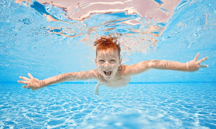 laughing underwater swimmer young boy
