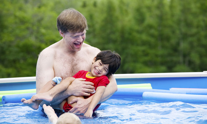 father with disabled son in pool