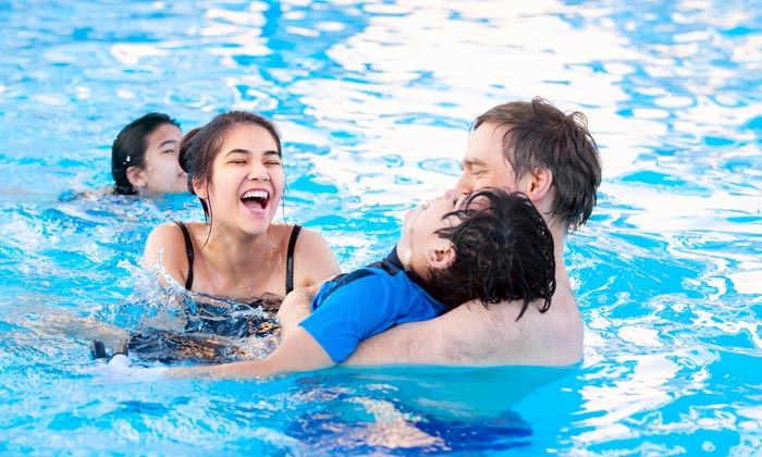 family with disabled child in pool