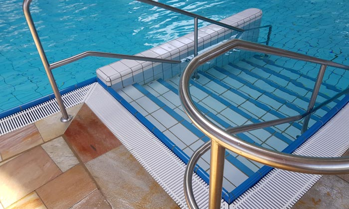 rails and stairs for disabled to access pool