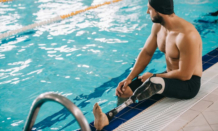 man with prosthetic leg at pool