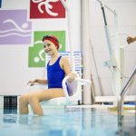 woman with disability at swimming pool