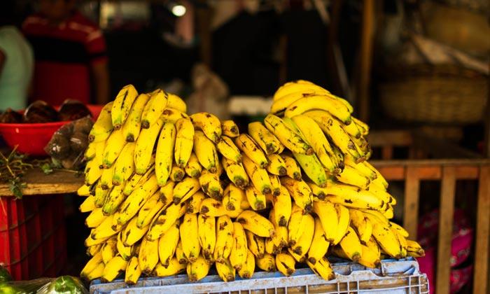 stack of bananas at local market in masaya nicaragua