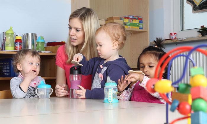 daycare children taking a drink break