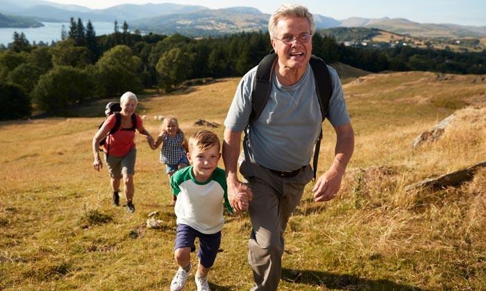 grandparents hiking with grandkids
