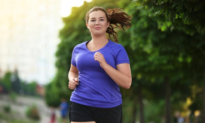 young adult woman jogging