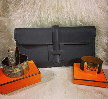 black epsom jige clutch and enamel bangles and black leather kelly dog bracelet