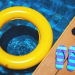 deck by pool with flipflops and float
