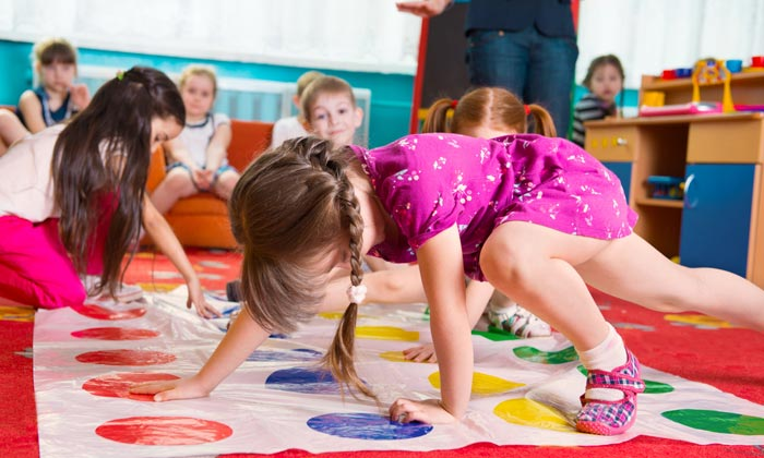 little girls at daycare playing on floor game