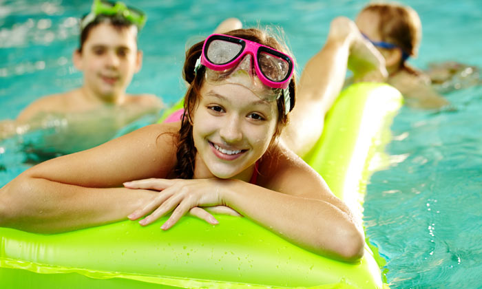 happy teen girl swimmer with friends