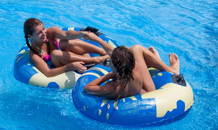 young women with braids floating in pool