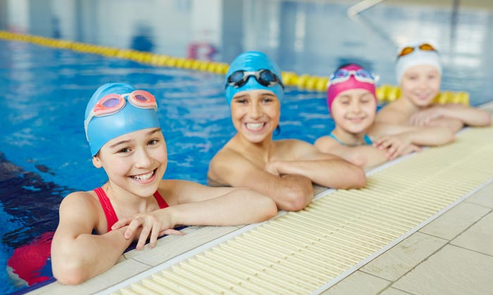 girls resting during swim lessons