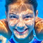 underwater girl smiling in pool