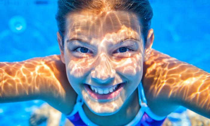 underwater girl smiling in pool