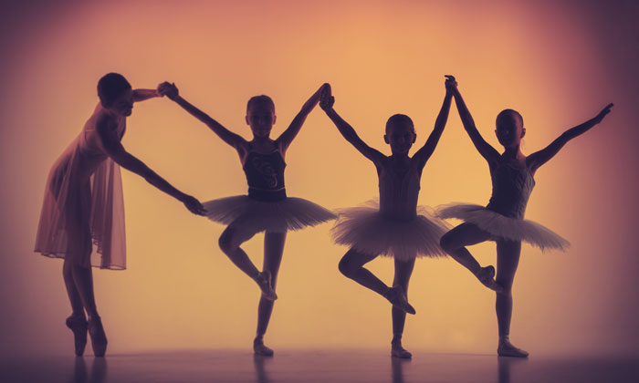 young ballerinas in silhouette