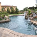 backyard paradise with pool and waterfall
