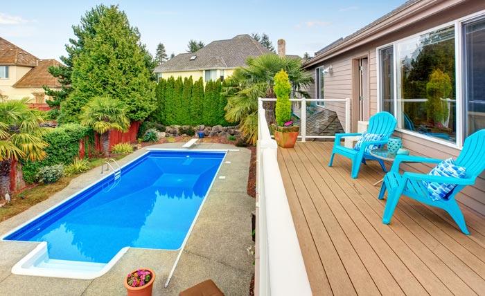 deck overlooking long narrow rectangular pool