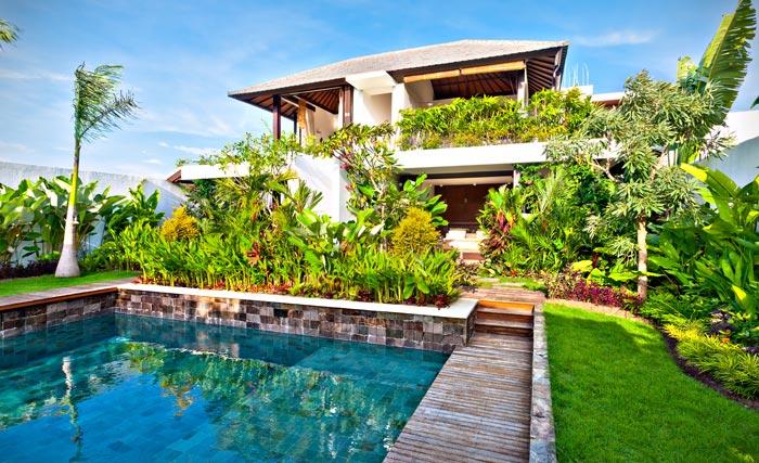 Lush greenery surrounding backyard pool