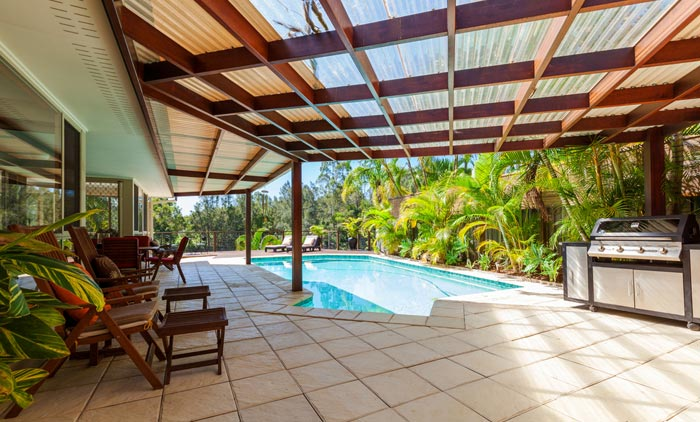 shade awning coverage over part of backyard pool